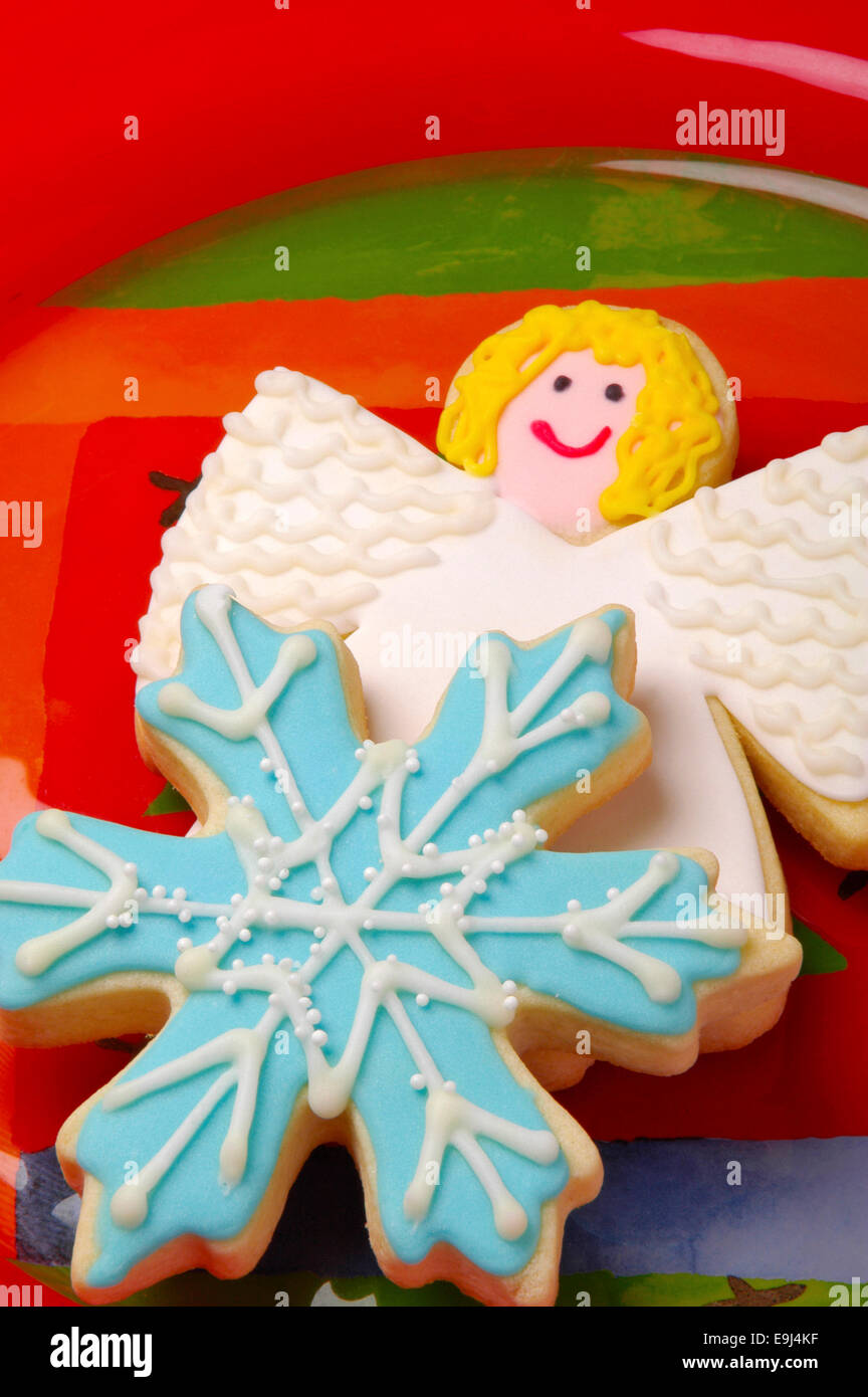 Close Up Of Beautifully Decorated Snowflake And Angel Iced Christmas Cookies On A Blue Plate With Studio Lighting
