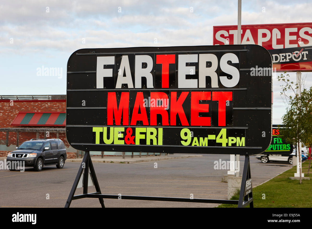 farmers market sign changed to farters market Saskatchewan Canada - Stock Image