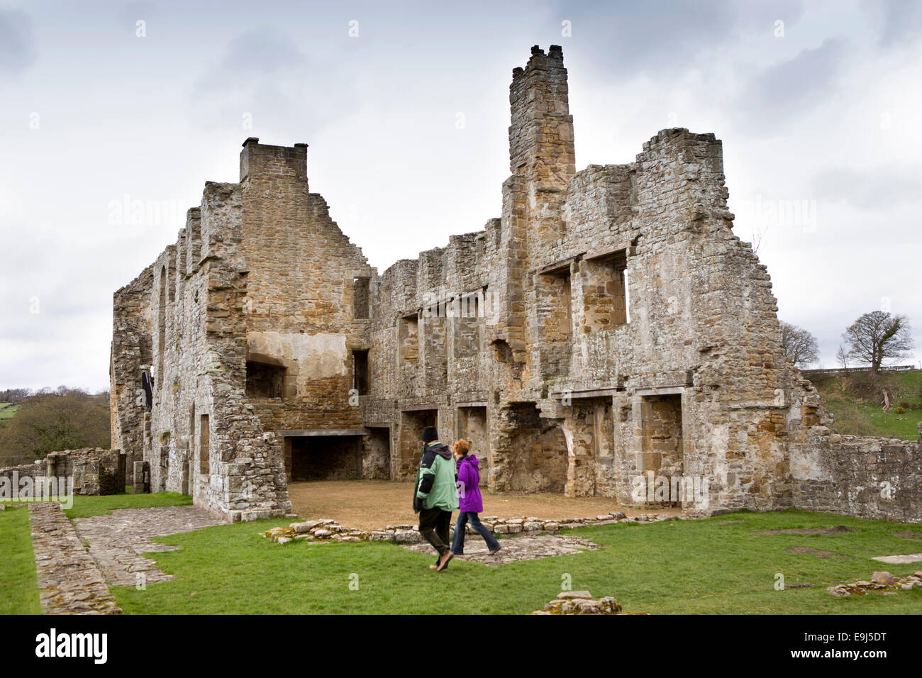 UK, Country Durham, Barnard Castle, Eggleston Abbey, visitors in ruins of monastery accommodation - Stock Image