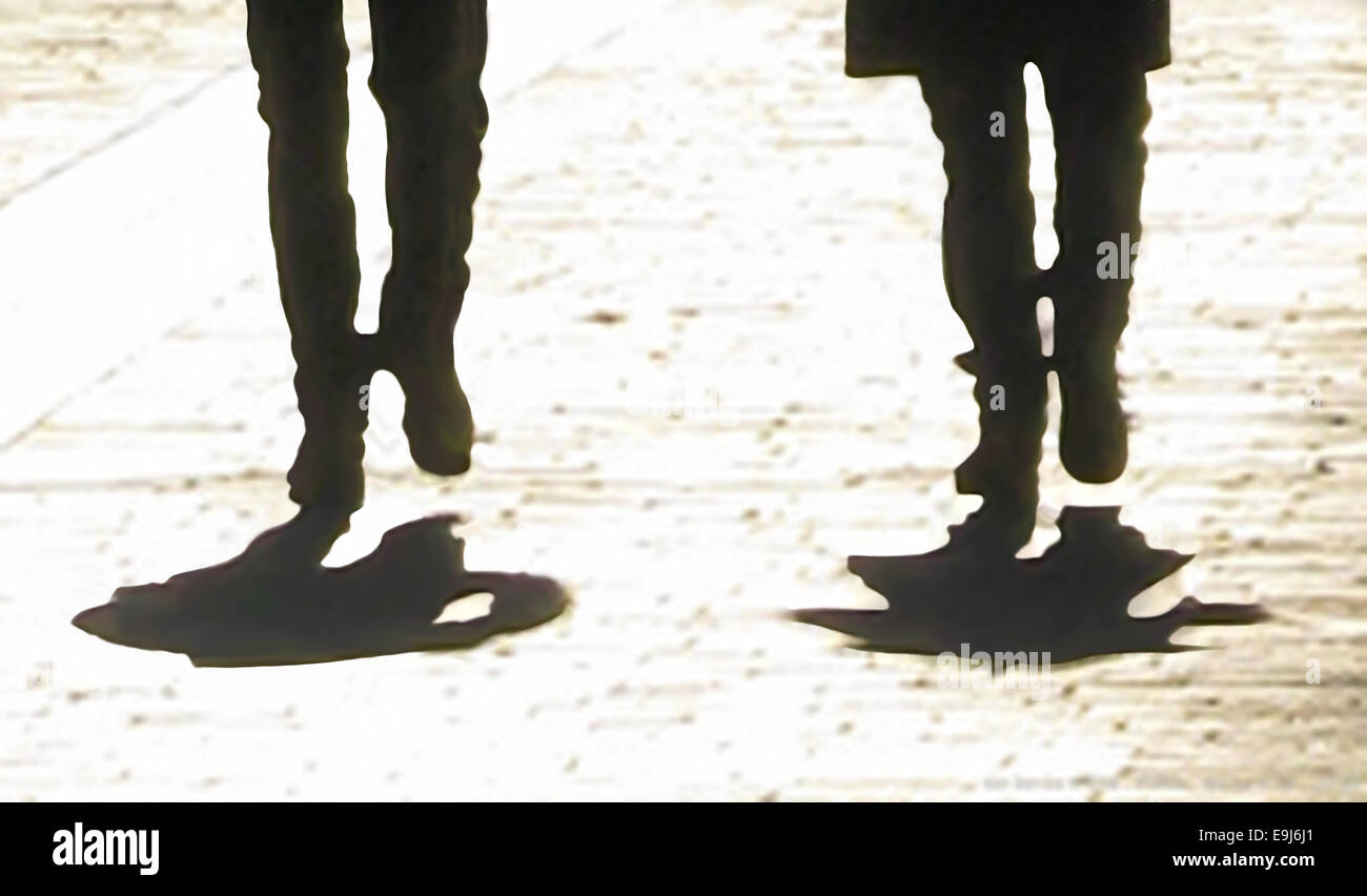 Walkers. Silhouetted legs with shadow, abstract digital pen sketch, based on photo. Stock Photo