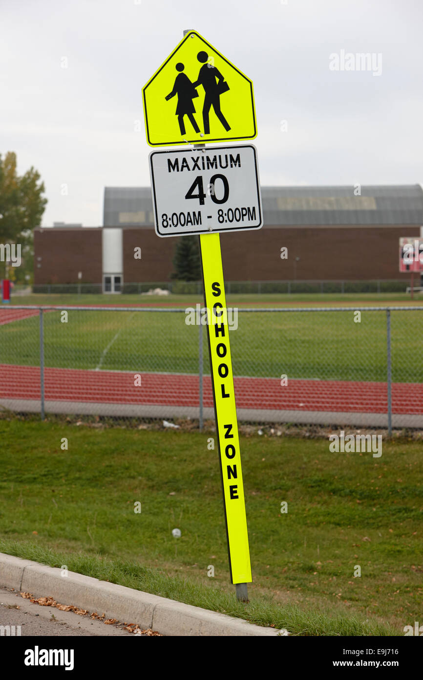 maximum 40 school zone warning sign outside school in Saskatchewan Canada - Stock Image