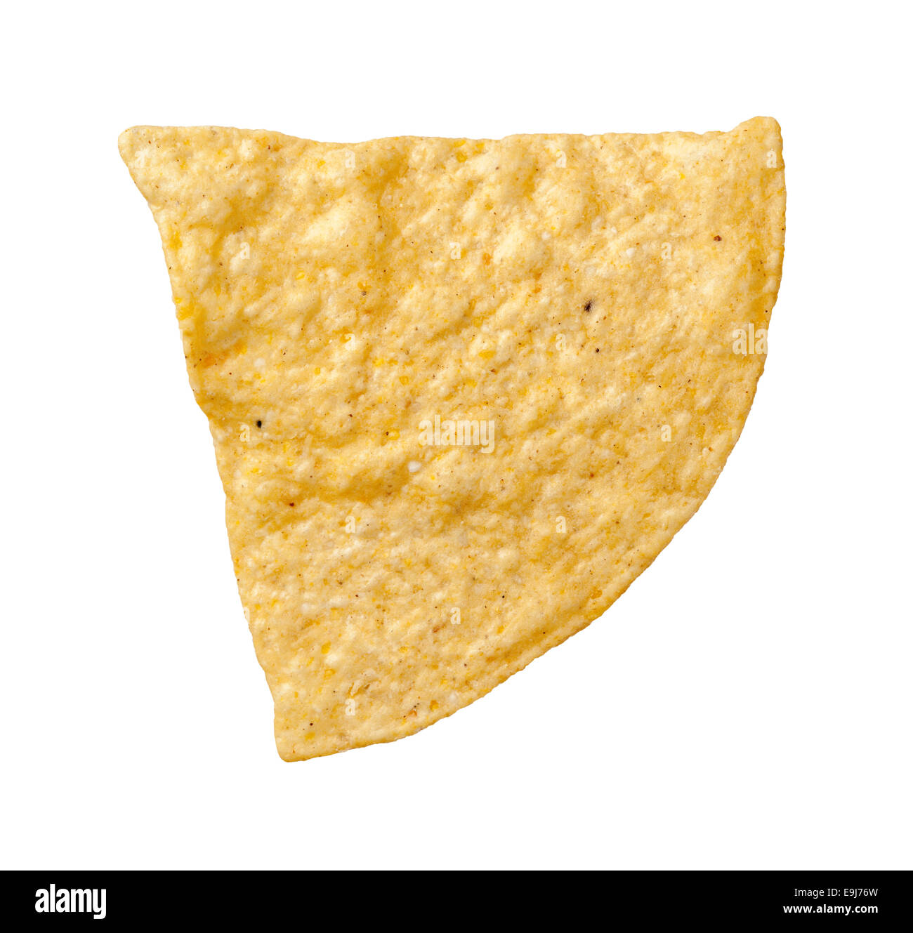 A single tortilla chip isolated on a white background. Tortillas are a salty snack associated with parties. - Stock Image