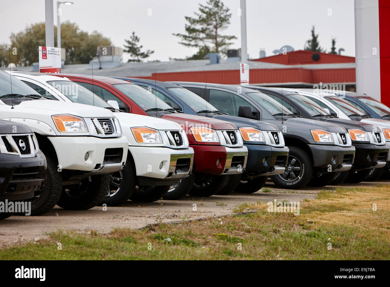 new cars on lot of dealership nissan new car dealership Saskatchewan Canada - Stock Image