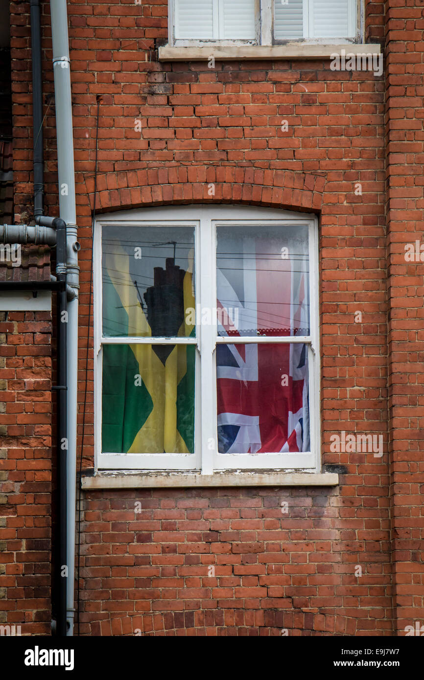 window with Jamaican and British flag - Stock Image