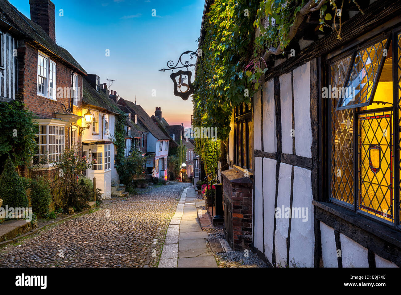 Dusk at a row of beautiful old houses on a cobbled street in Rye, East sussex - Stock Image