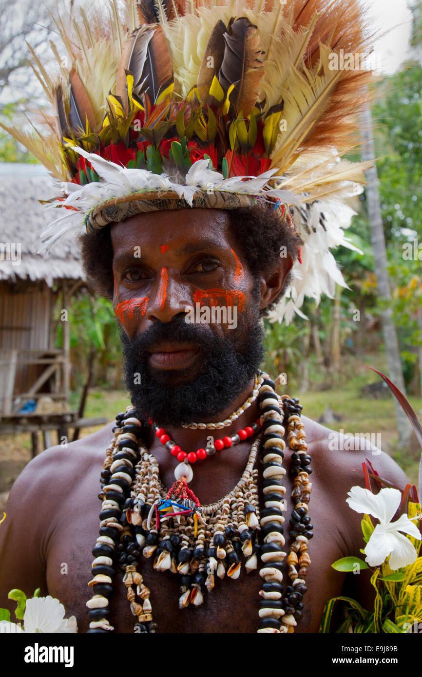 Man of Tufi, Papua New Guinea, with a Headdress of Bird of Paradise Feathers - Stock Image