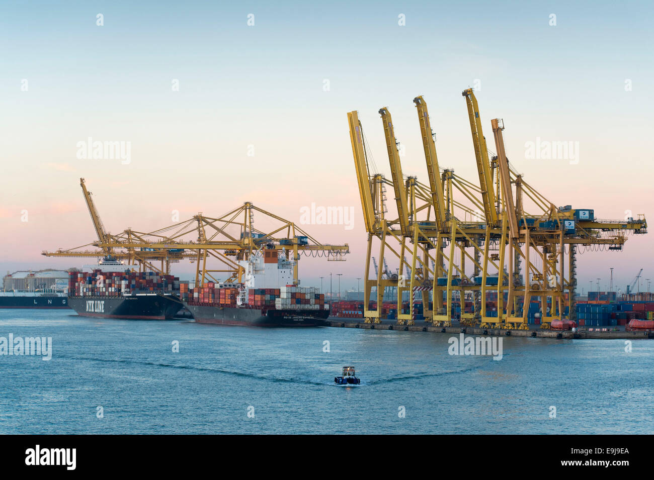 Cargo ships docked for import and export at Barcelona international shipping port in Barcelona, Spain. - Stock Image