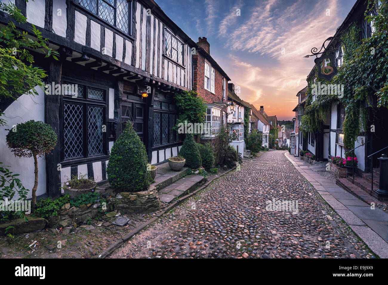 Beautiful tudor style half timbered houses lining a cobbled street in Rye, Sussex, retro vintage effect. - Stock Image