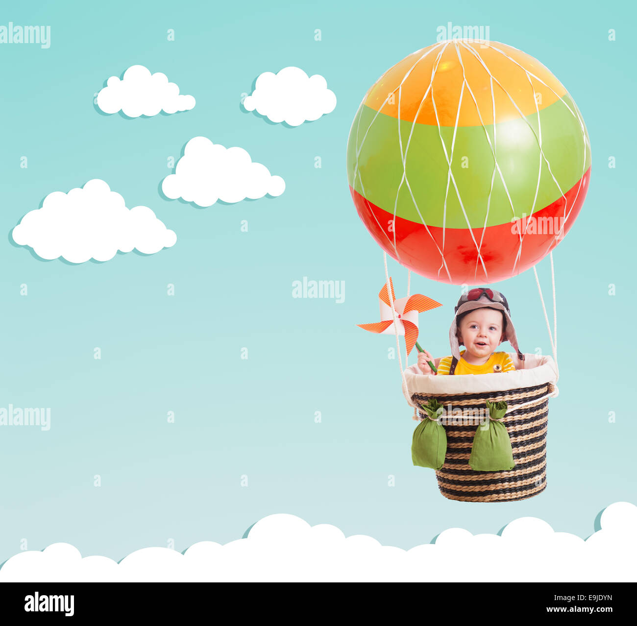 cute kid on hot air balloon in the blue sky Stock Photo