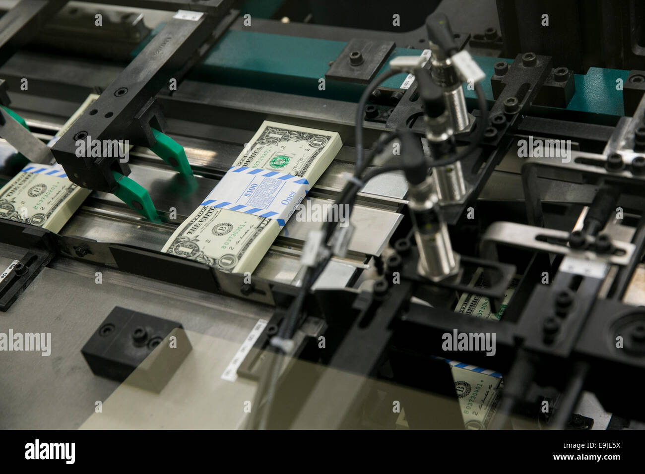 Bundles of United States One Dollar ($1) bills during production at the Bureau of Engraving and Printing in downtown - Stock Image