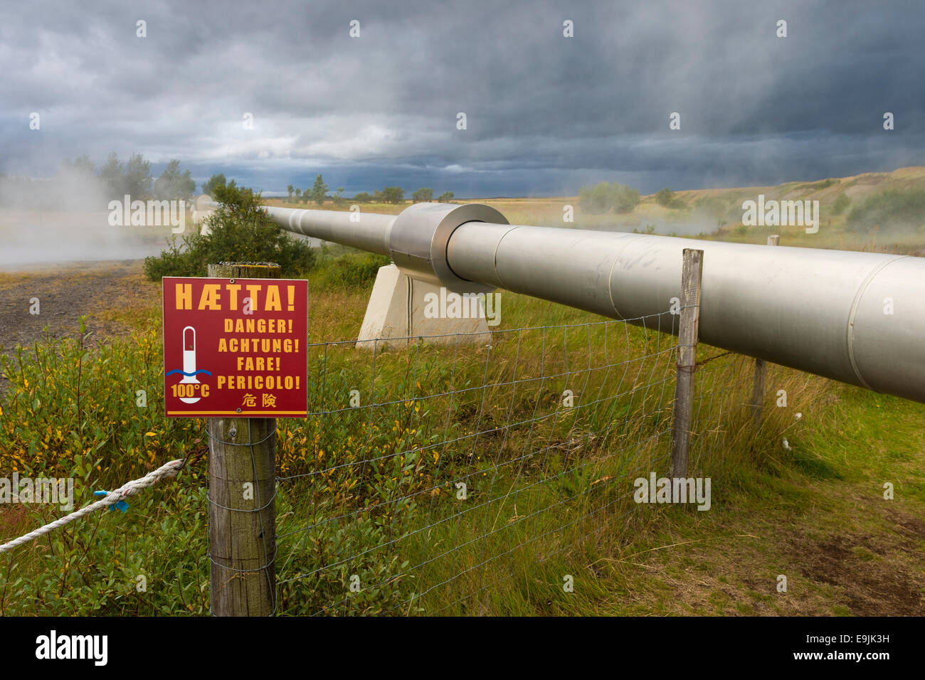 Warning sign, pipeline with boiling water for the supply of Akranes and Borgarnes, Deildartunguhver, highest-flow - Stock Image