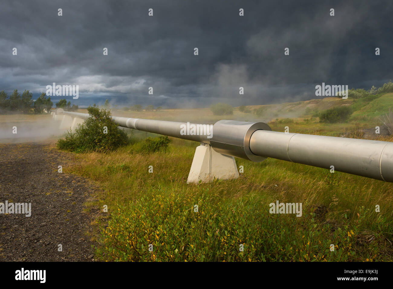 Pipeline with boiling water for the supply of Akranes and Borgarnes, Deildartunguhver, highest-flow hot spring of - Stock Image