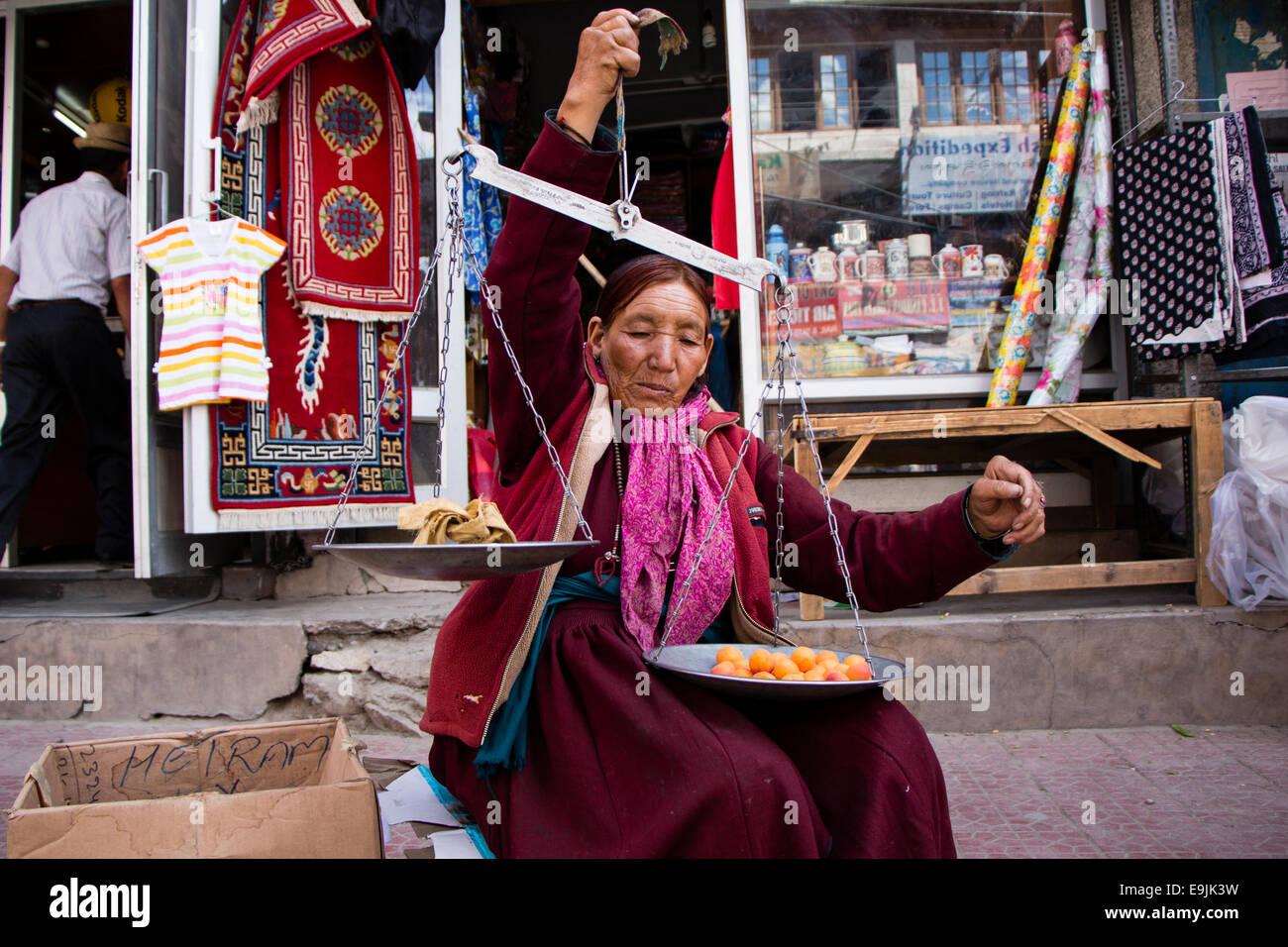 Woman selling apricots, Leh, Ladakh, Jammu and Kashmir, India - Stock Image
