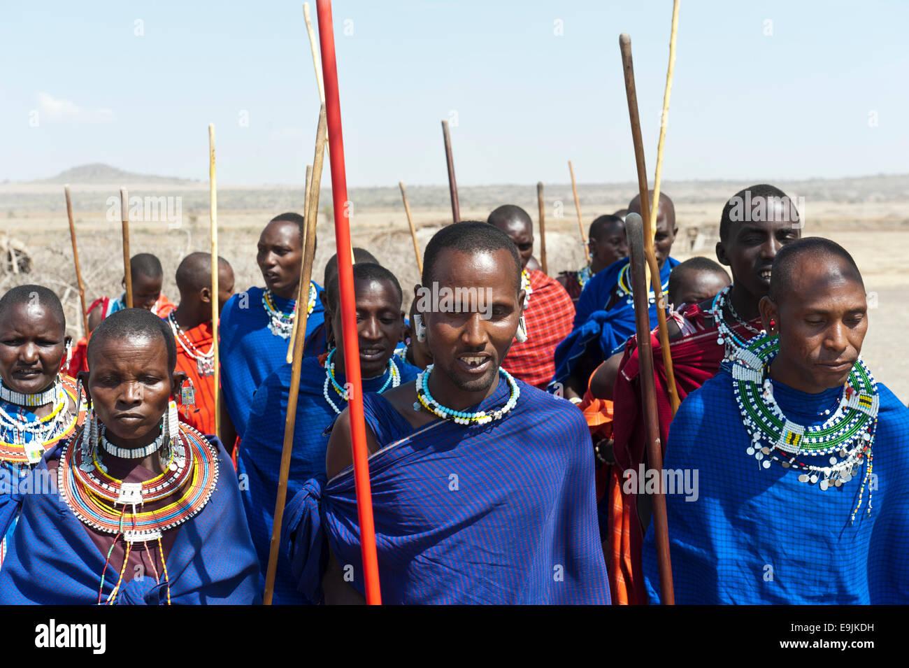 Maasai, group of men and women, Ngorongoro Conservation Area, Kiloki, Tanzania - Stock Image