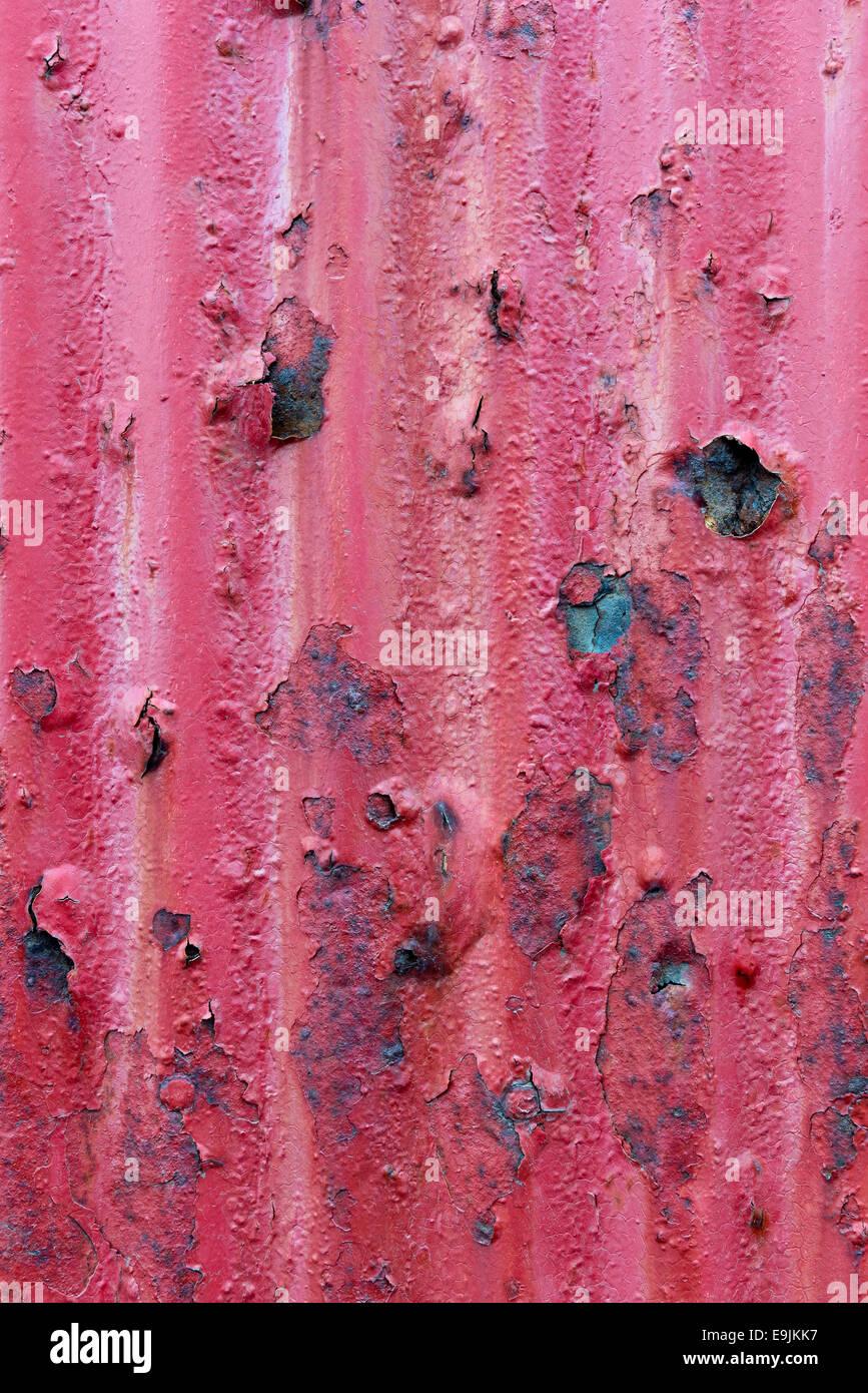 Rusty red corrugated iron sheet - Stock Image