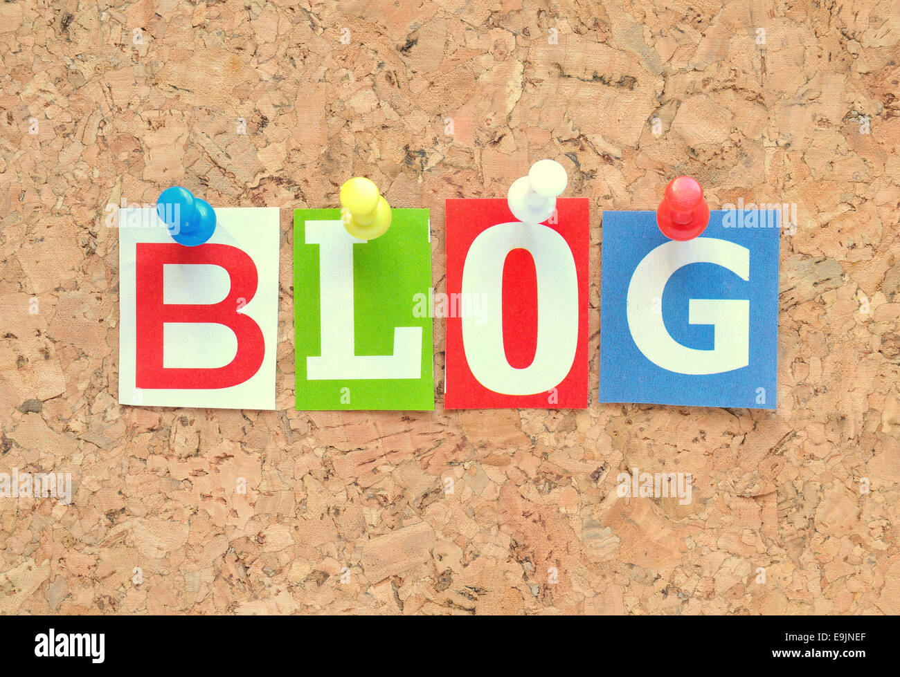 Blog with multicolored newspaper letters on a cardboard - Stock Image