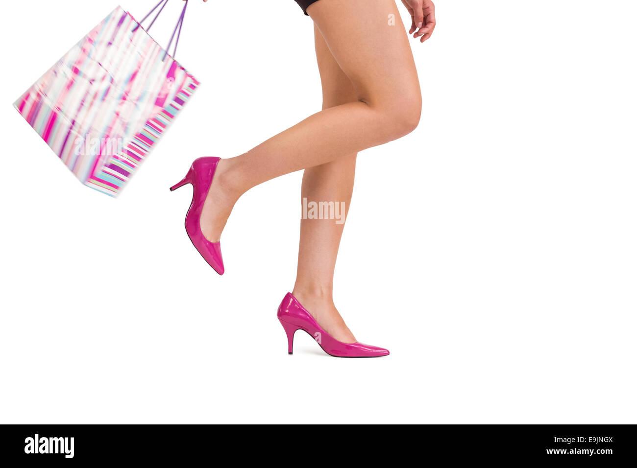 Womans legs in high heels - Stock Image