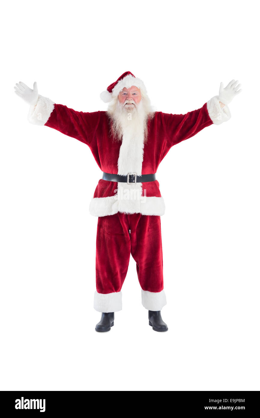 Jolly Santa opens his arms to camera - Stock Image