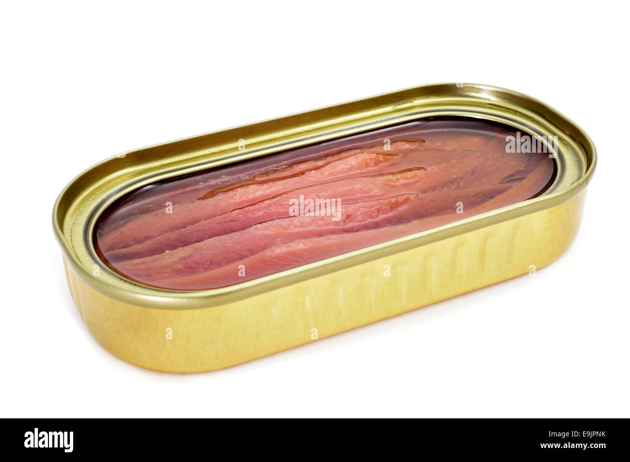 an open can of anchovies on a white background - Stock Image
