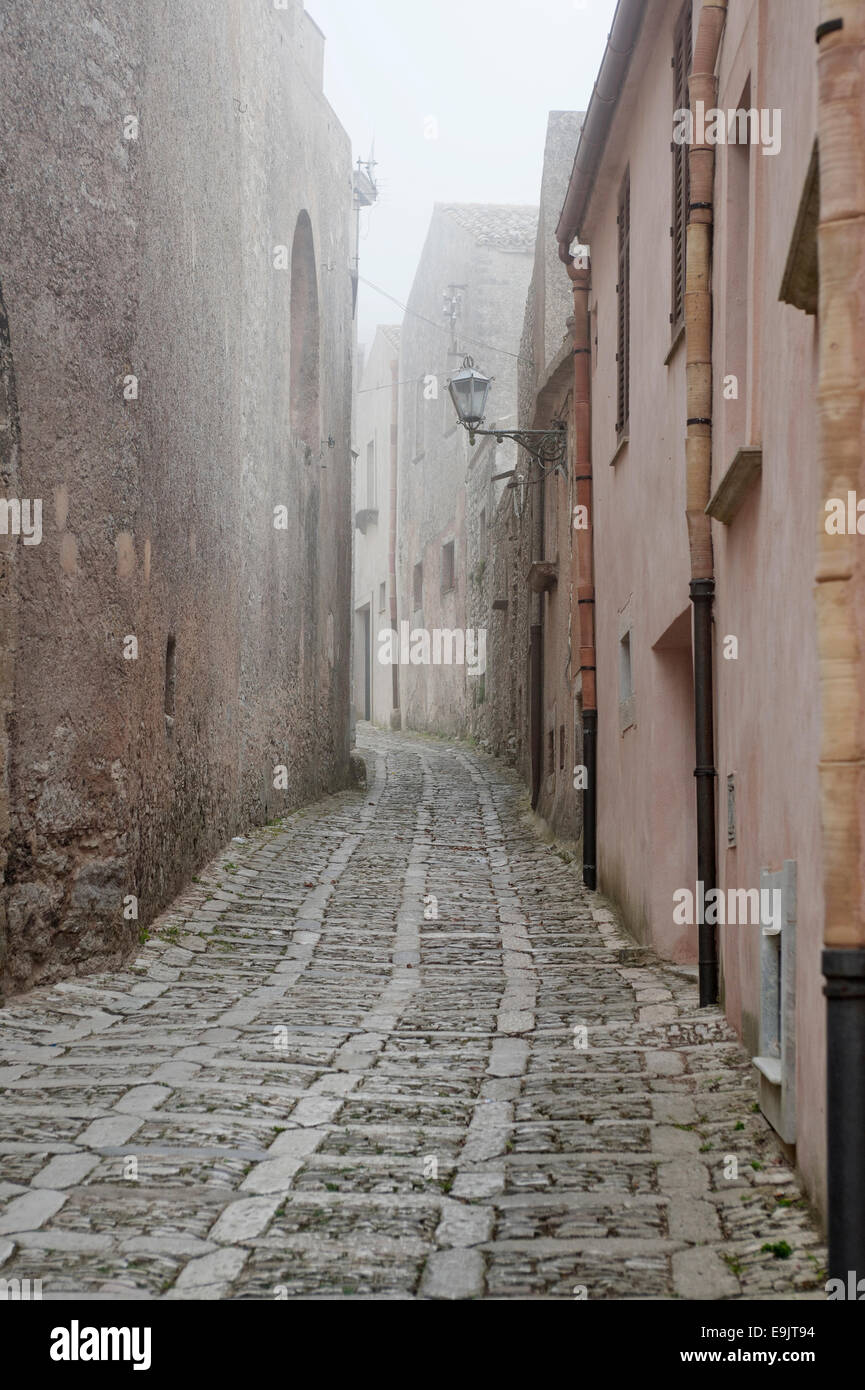 view of ancient road with fog in Erice, Sicily - Stock Image