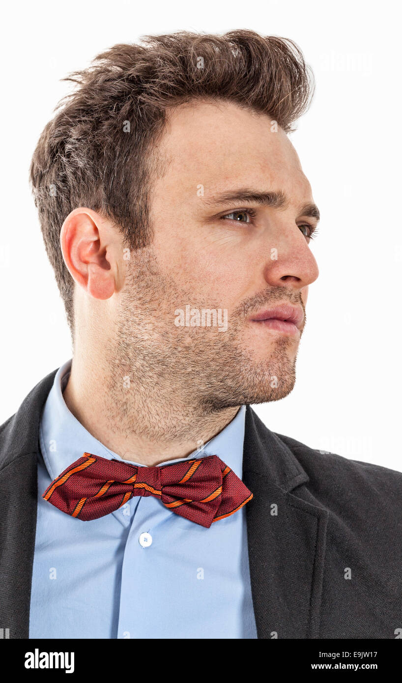 Profile of a young businessman with a red bow, against a white background. - Stock Image