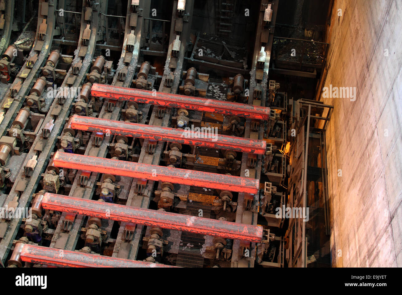 Red hot steel blooms in continuous casting machine. - Stock Image