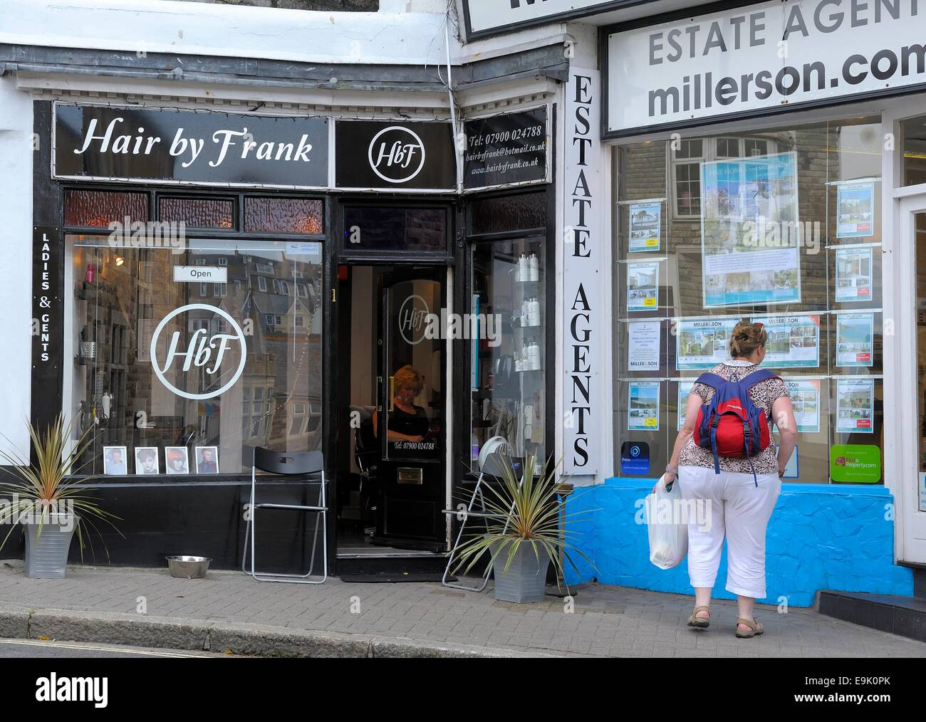 Hairdresser and estate agent next door to each other St Ives Cornwall England uk & Hairdresser and estate agent next door to each other St Ives ...