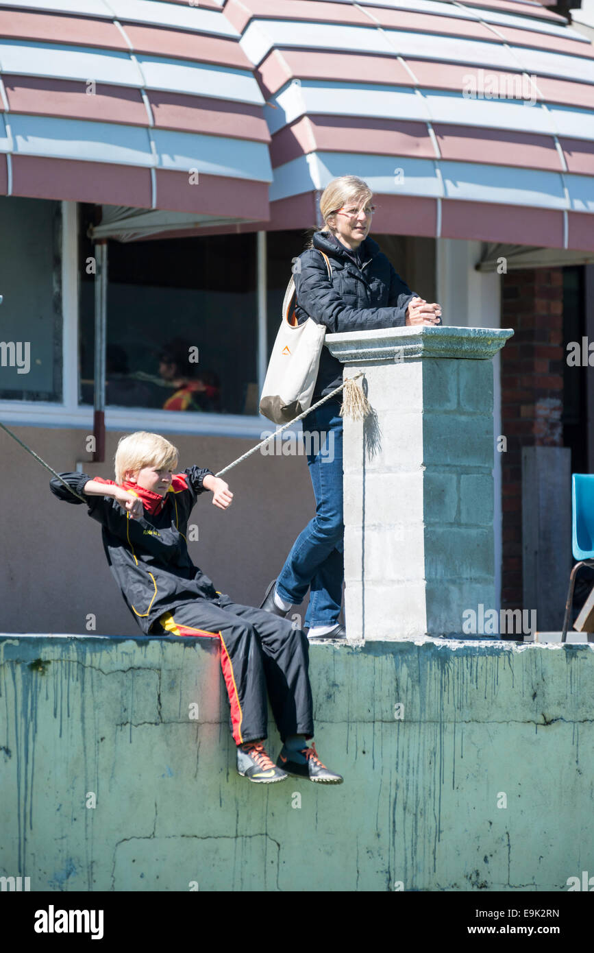 Mother and son watching a football match, Cape Town, South Africa - Stock Image