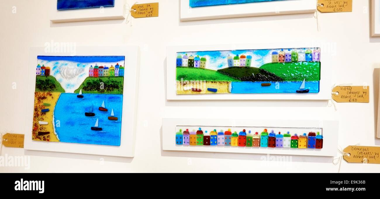 Hand crafted fused-glass pictures using coloured and clear glass by artist Debbie Lord - Stock Image