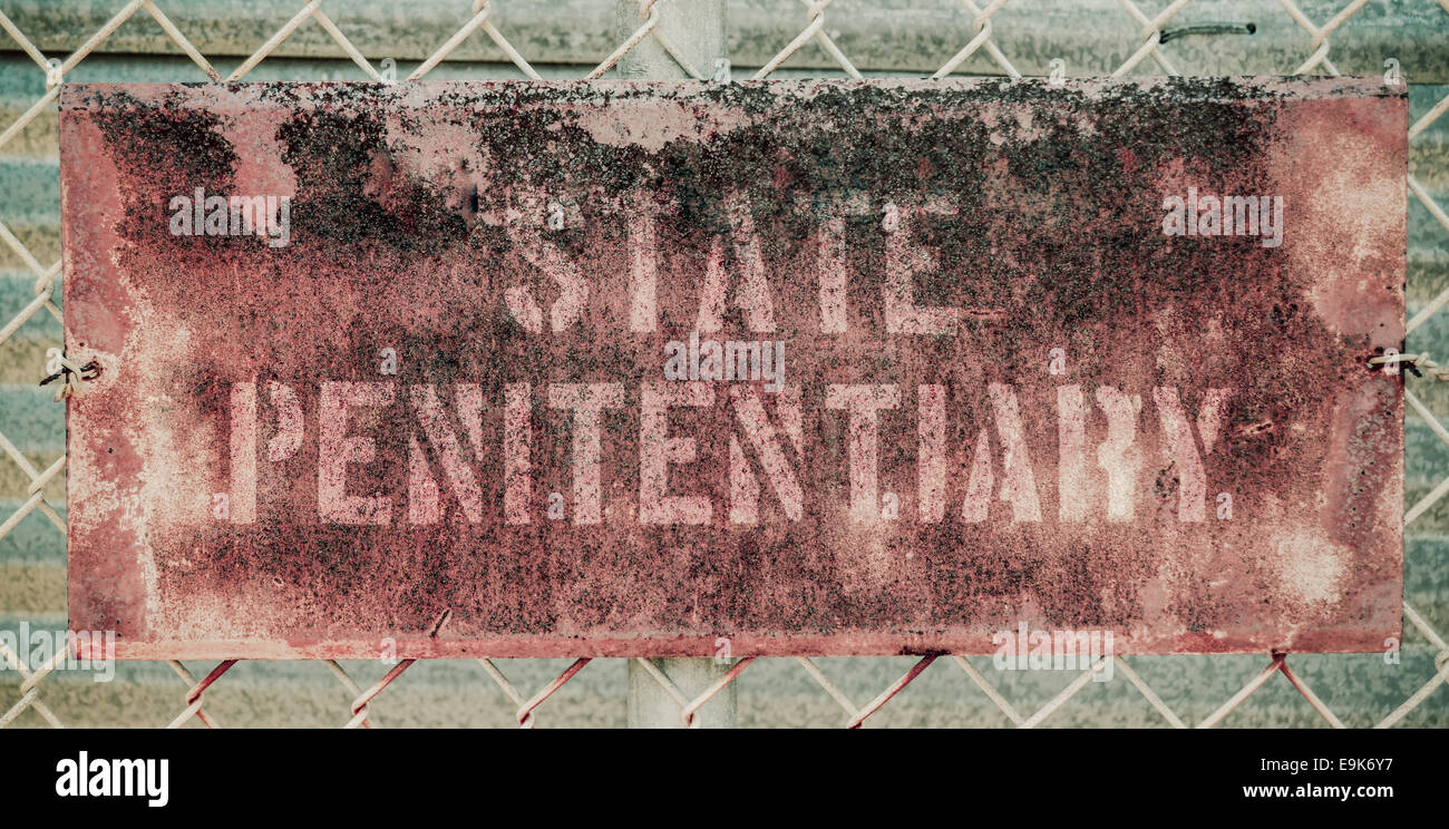 Grungy State Penitentiary Prison Sign - Stock Image