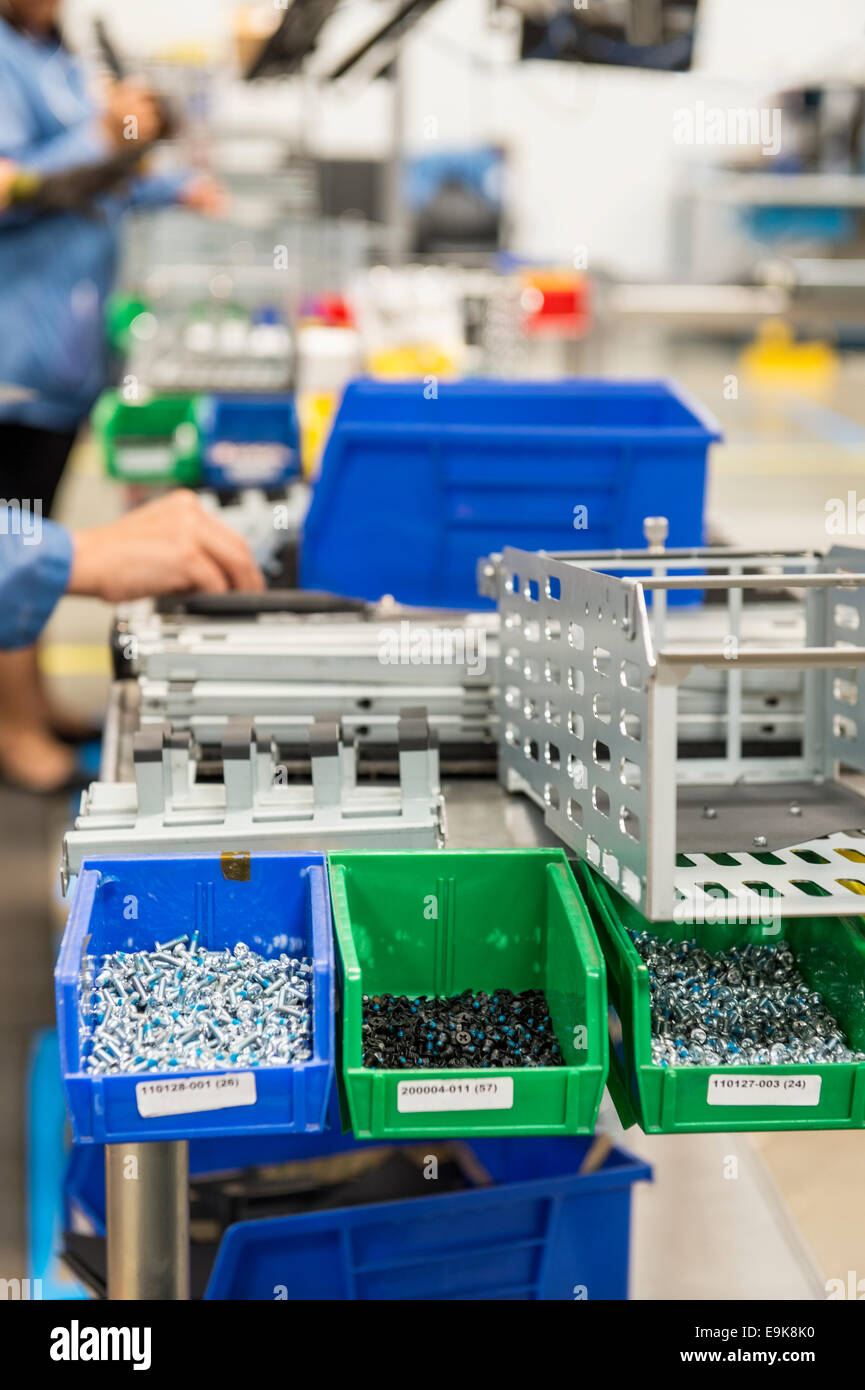Variety of screws in tray at computer manufacturing industry - Stock Image