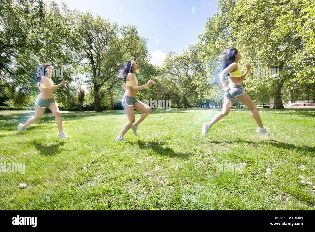 Multiple image of young fit woman jogging at park - Stock Image