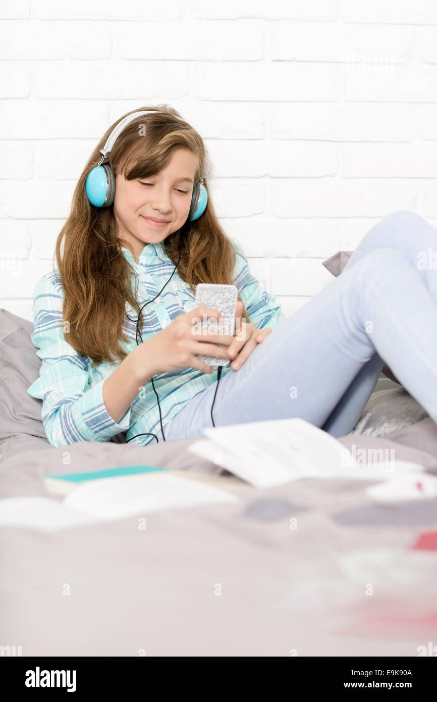Girl listening to music at home - Stock Image