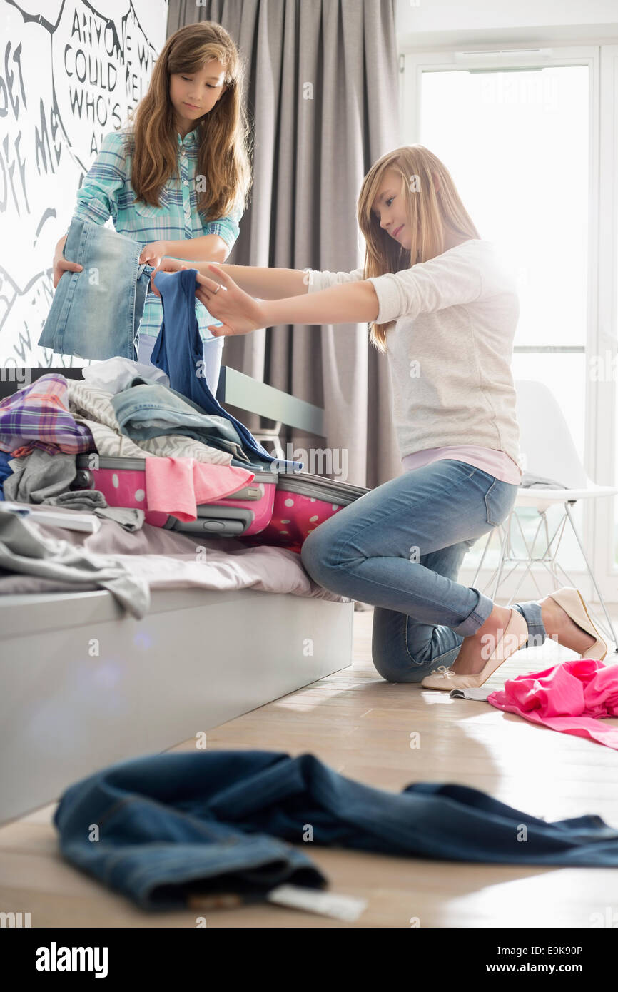 Sisters cleaning bedroom - Stock Image