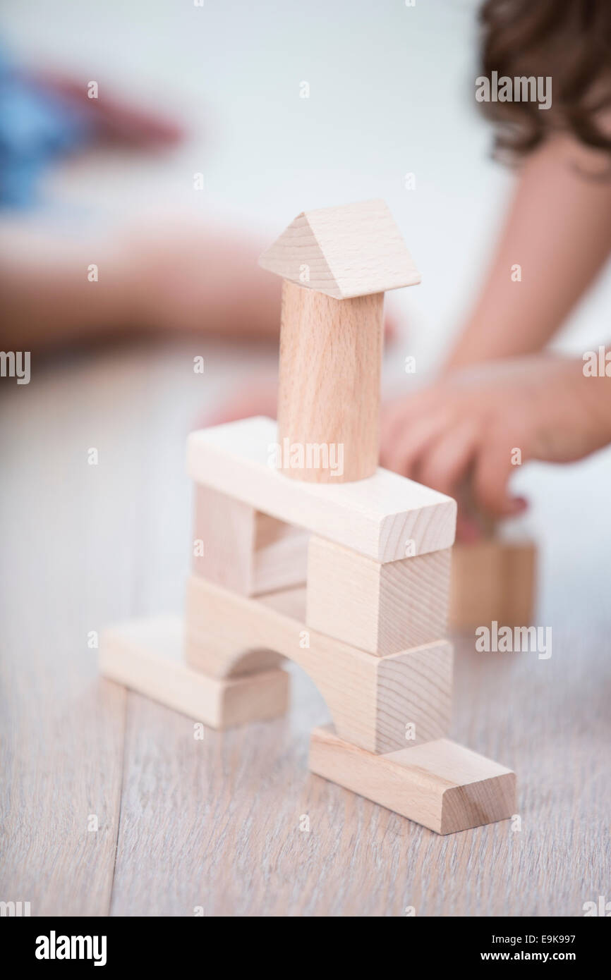 Close-up of wooden tower on hardwood floor - Stock Image