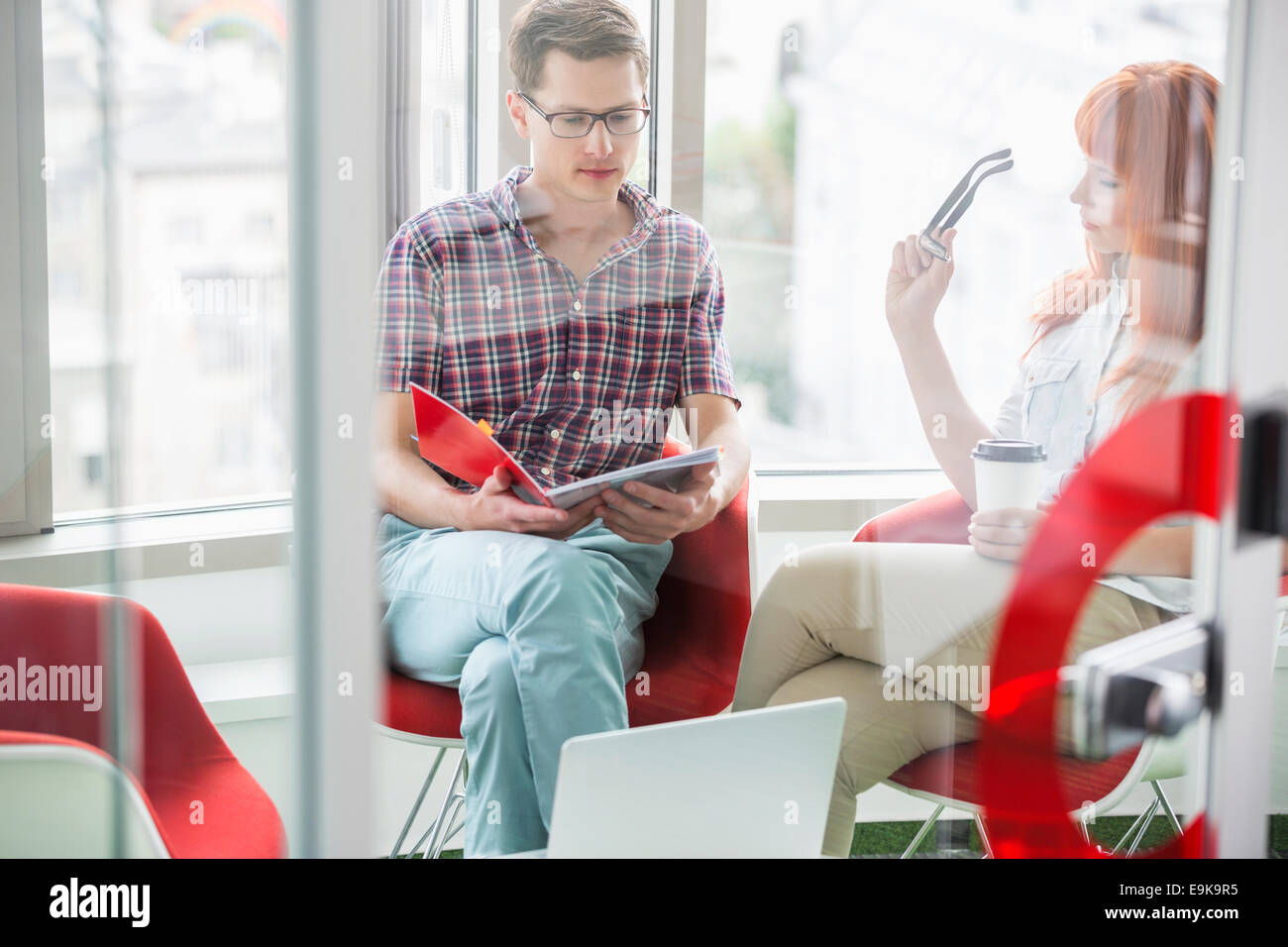 Business colleagues working in creative office - Stock Image