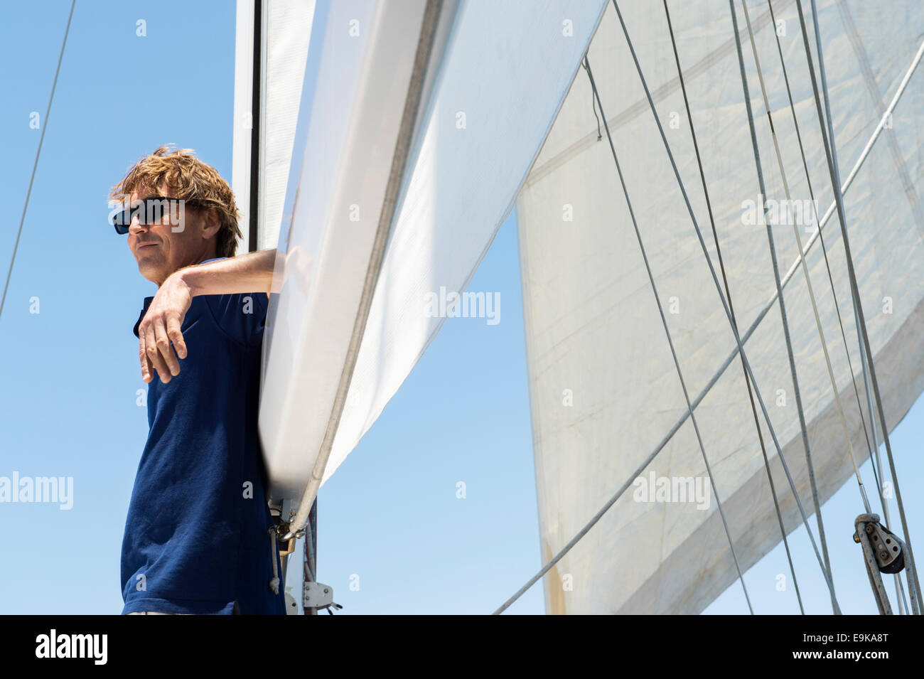 Side view of middle-aged man on yacht - Stock Image