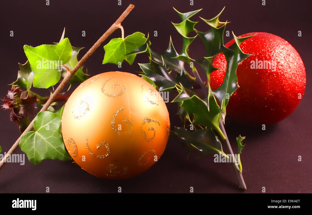Christmas holly and the ivy with baubles Stock Photo