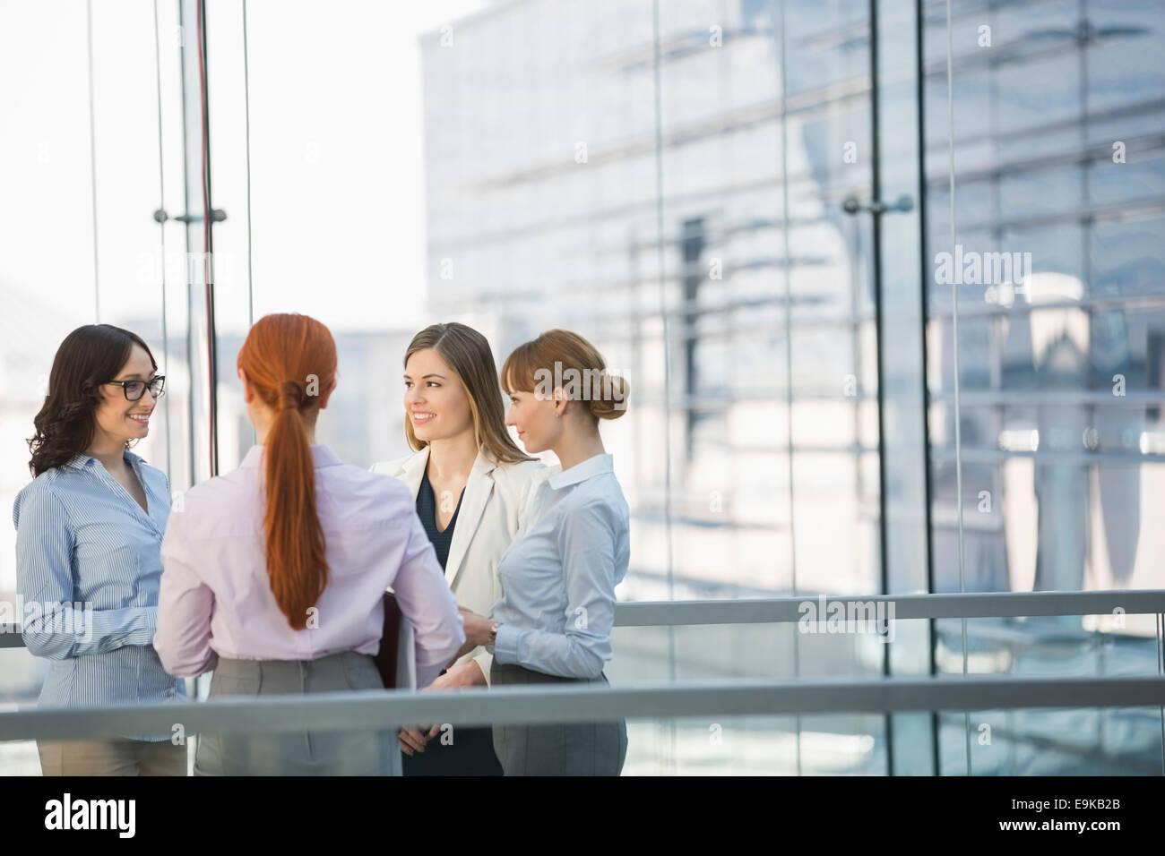 Businesswomen conversing in office - Stock Image