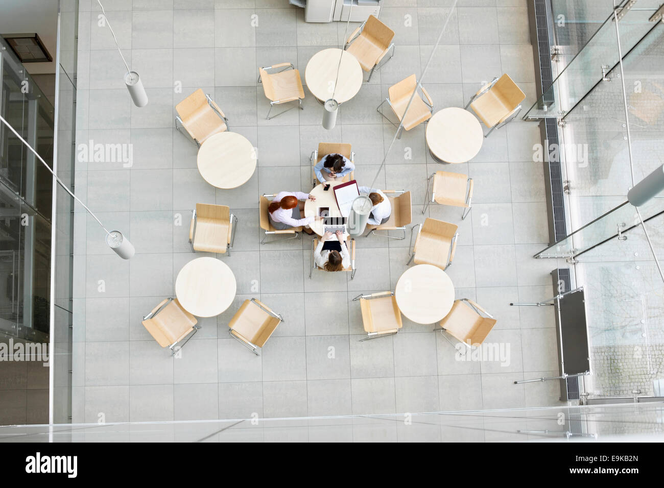 High angle view of businesswomen working in office canteen - Stock Image