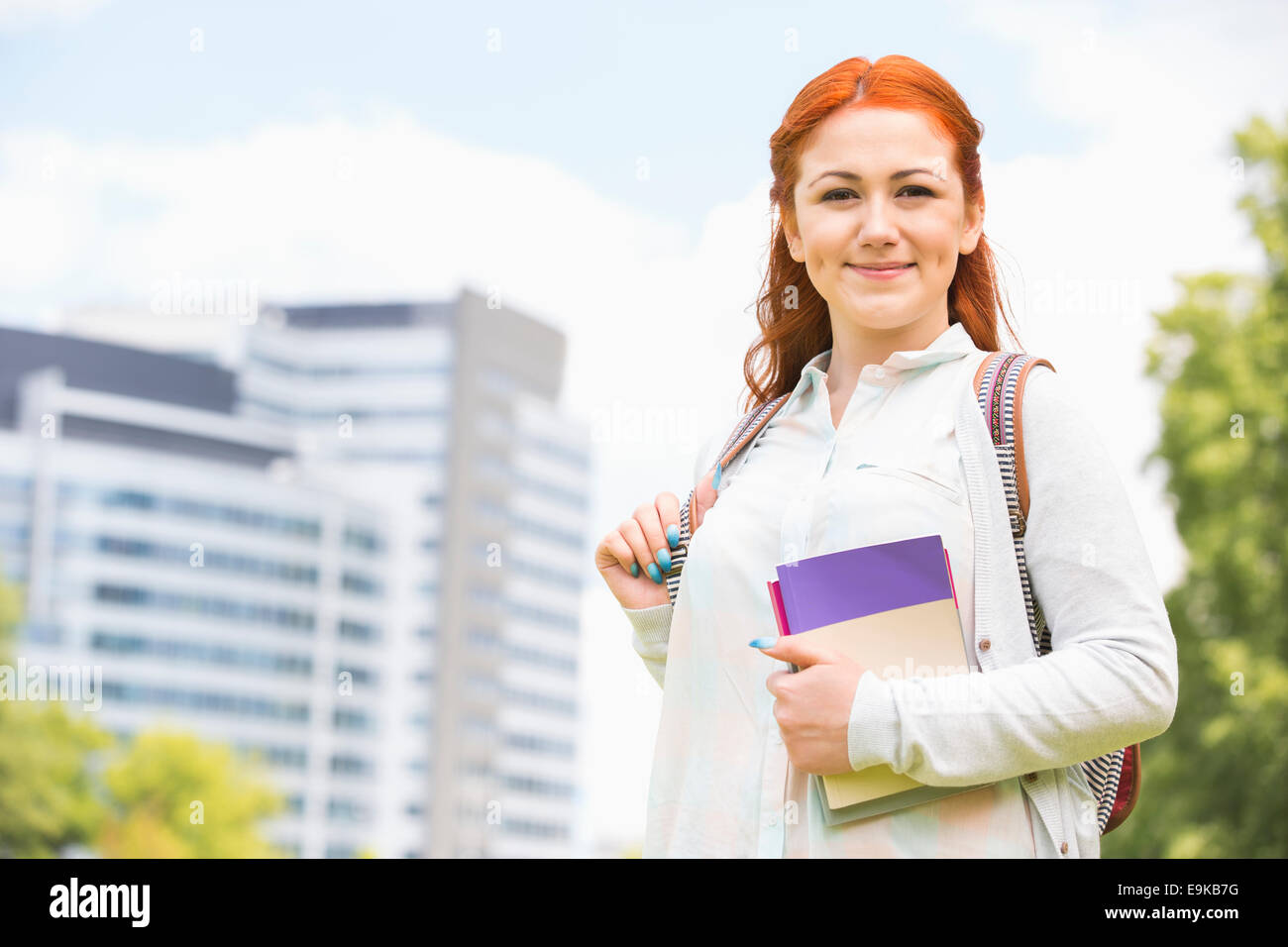 Portrait of beautiful college student at campus - Stock Image