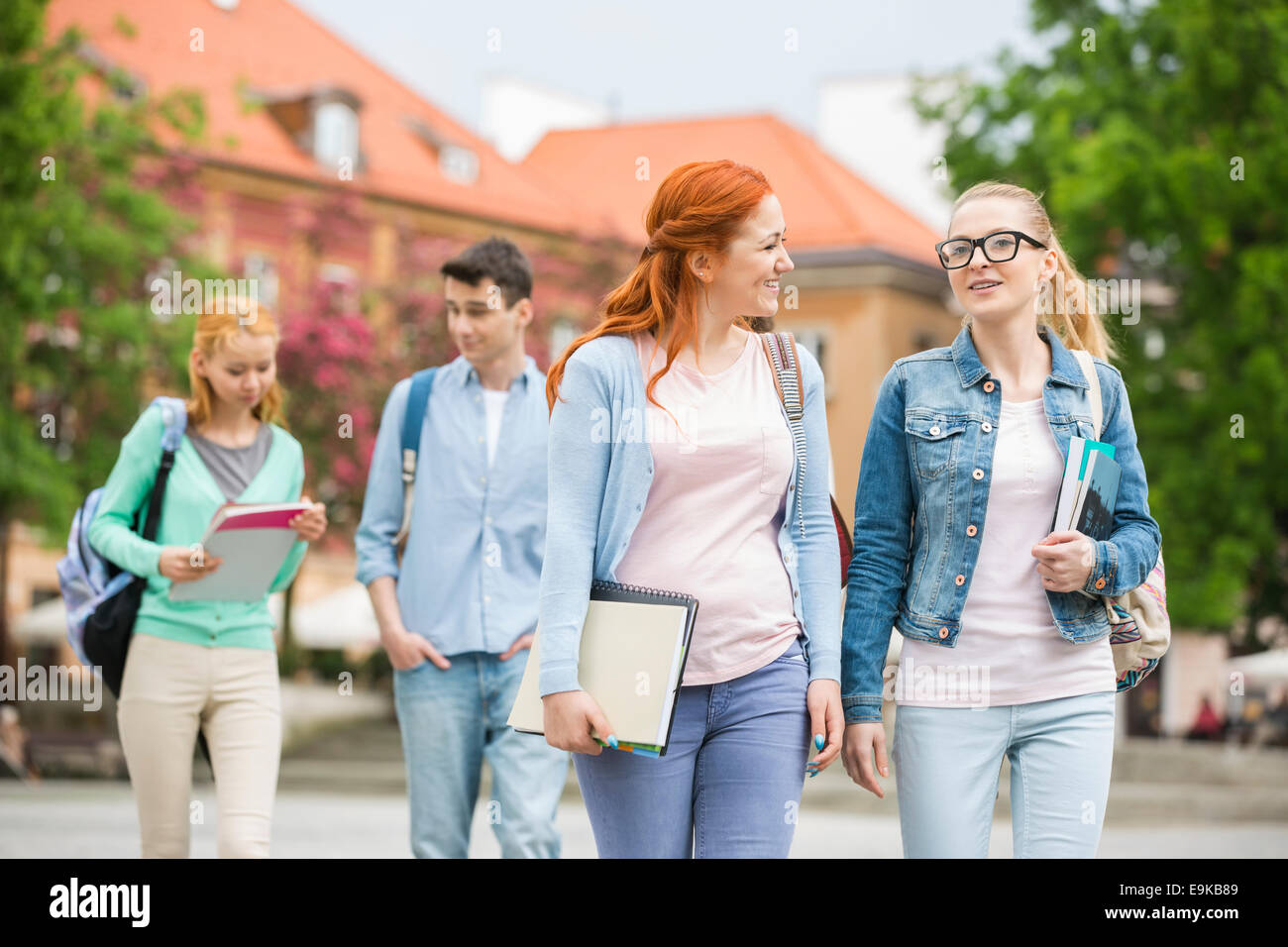 Young university friends walking on street - Stock Image