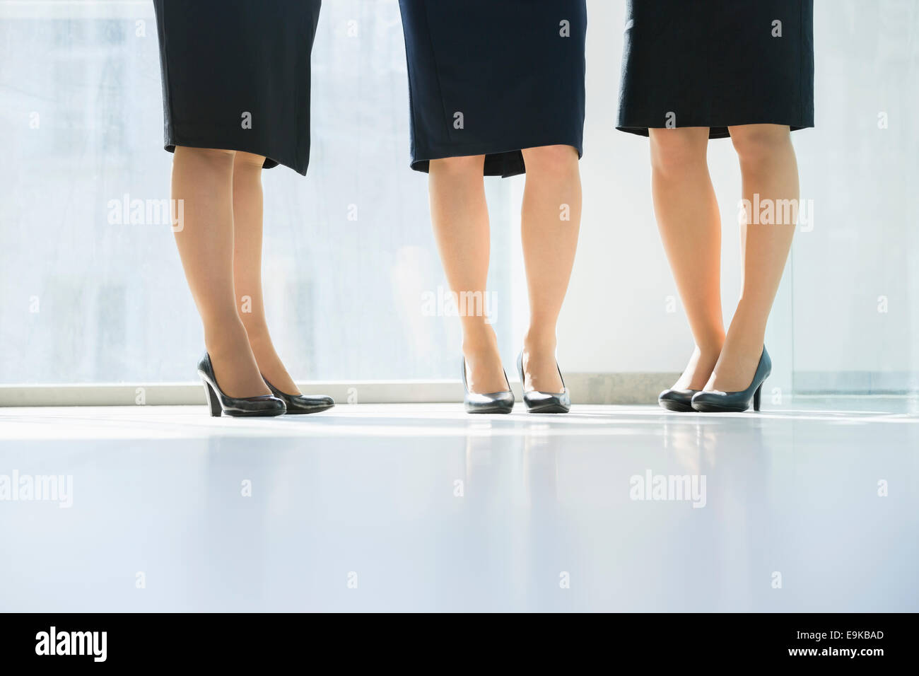 Low section of businesswomen standing in office - Stock Image