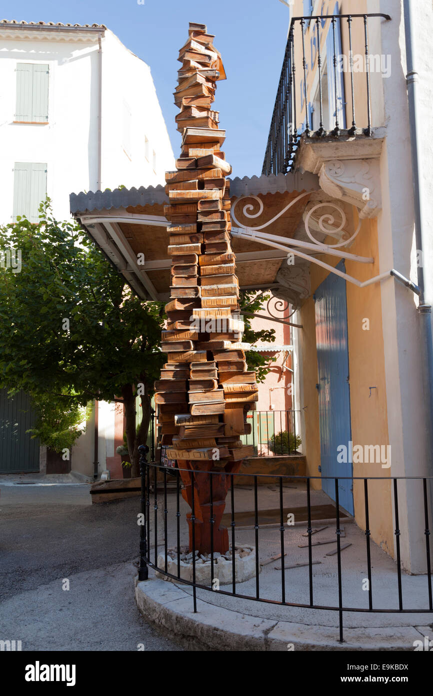 a stack of books as a sign in front of the cornflower bookshop