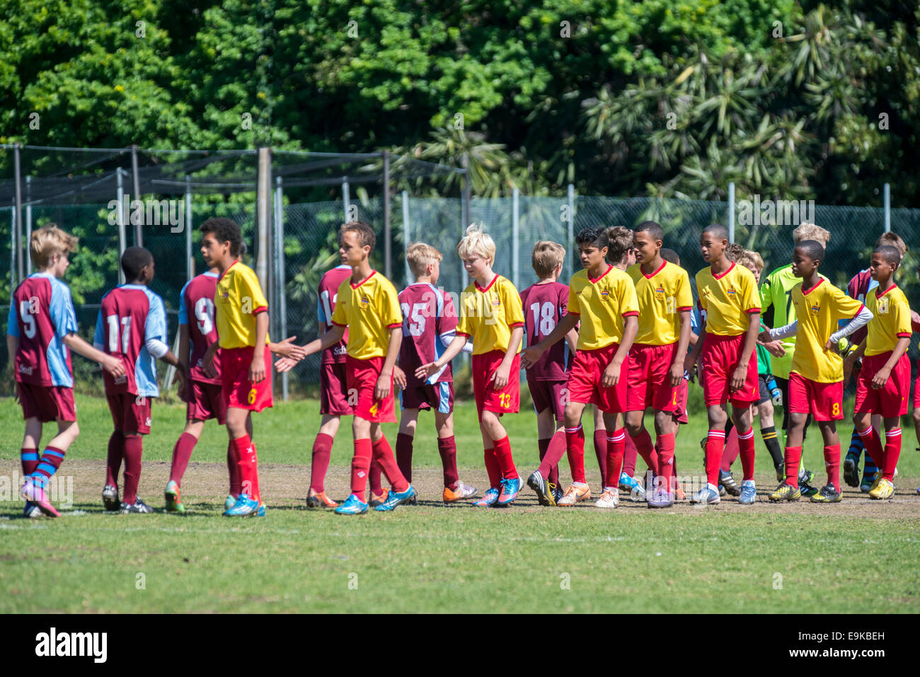 Youth football players (U13) greet each other after the match , Cape Town, South Africa - Stock Image