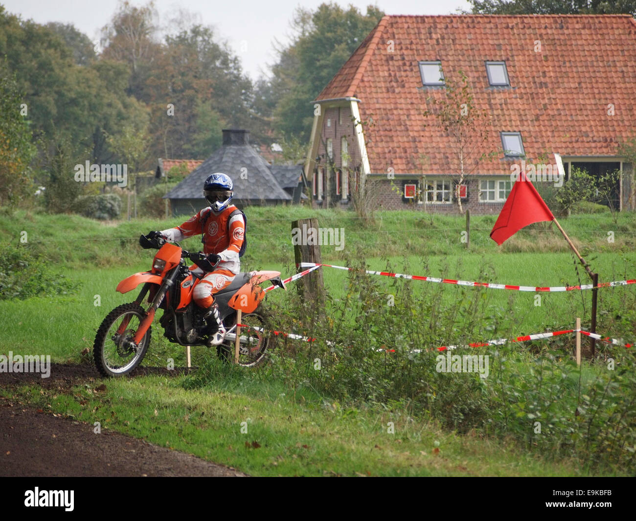 Man riding KTM cross motorcycle at an enduro event in Ruurlo, the Netherlands. - Stock Image