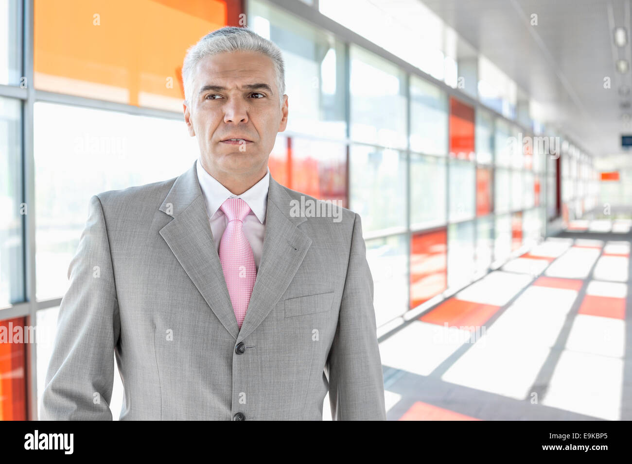 Middle aged businessman at railroad station - Stock Image