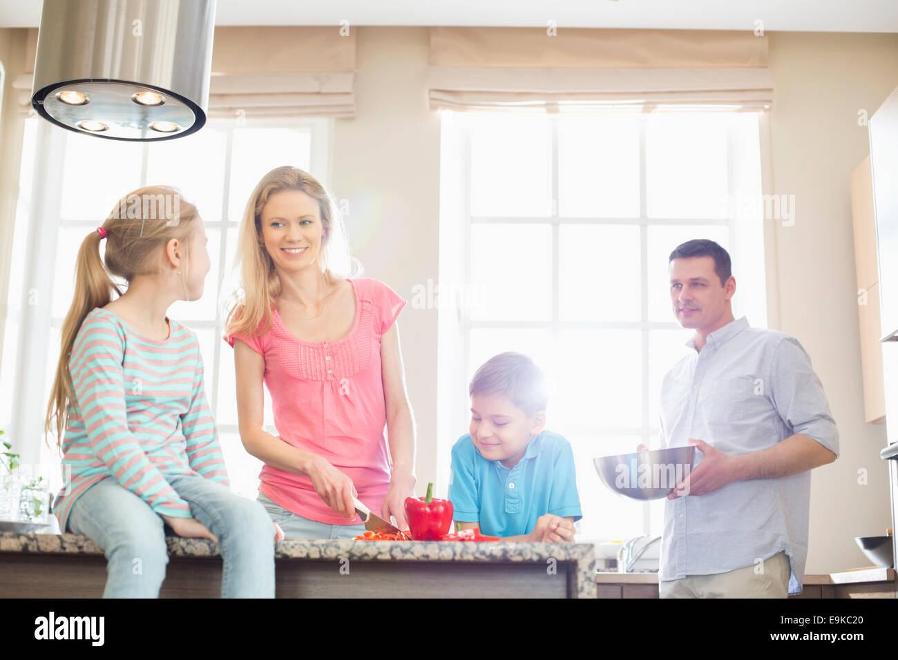 Family preparing food in kitchen - Stock Image