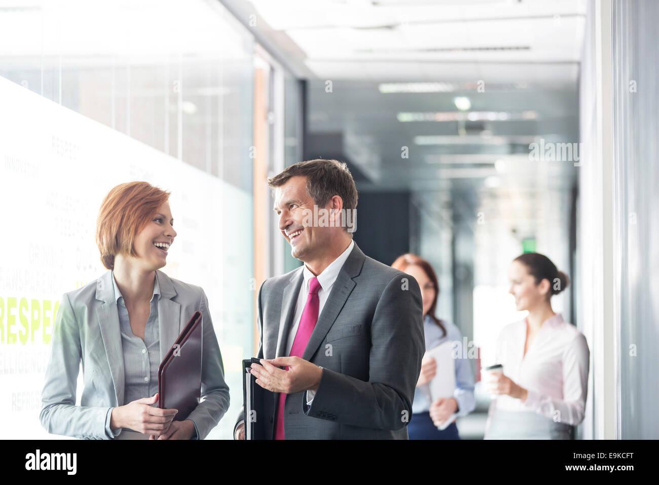 Business people walking in corridor Stock Photo