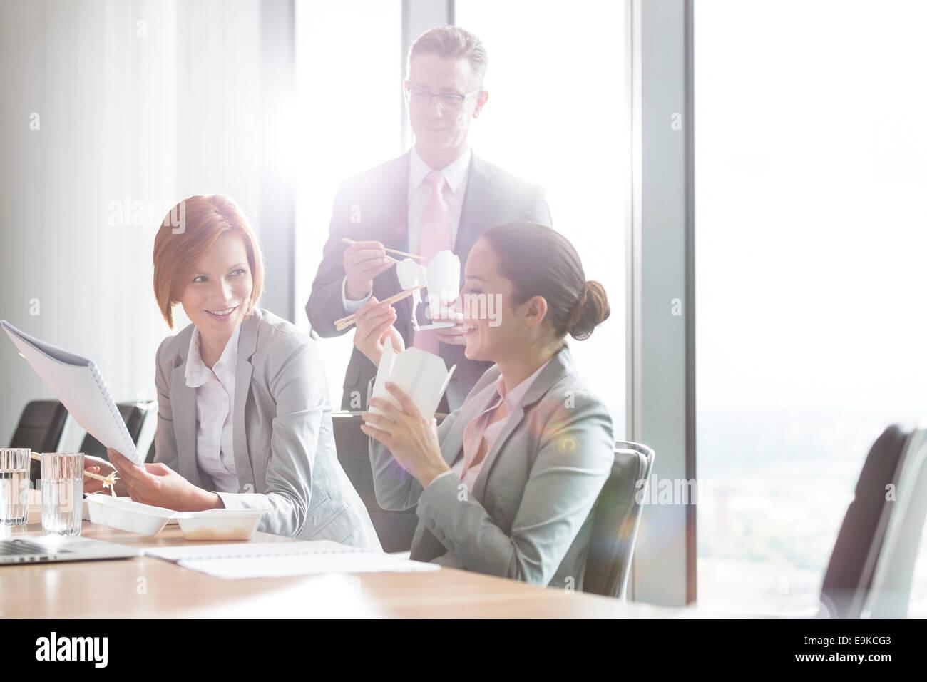Business people having lunch break - Stock Image
